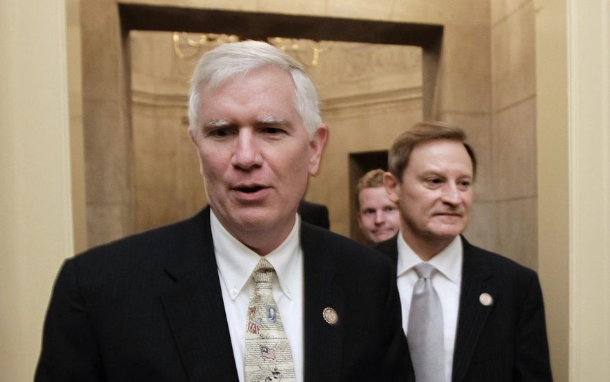 FILE - This July 28, 2011 file photo shows Rep. Mo Brooks, R-Ala., left, on Capitol Hill in Washington. House Republicans are pushing a plan to give young immigrants brought to the country illegally by their parents a path to resident status if they join the U.S. military. Rep. Jeff Denham of California said Friday he would press for a vote on his legislation either as a free-standing bill or as an addition to the defense authorization measure that the House will consider in May. Denham immediately faced conservative opposition. Brooks circulated a letter among his colleagues opposing any attempt to add immigration legislation to the defense bill. His intent was to collect as many signatures as possible and deliver the letter to House leadership. (AP Photo/J. Scott Applewhite, File)