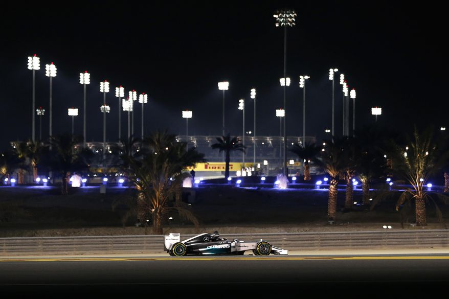 Mercedes driver Lewis Hamilton of Britain steers his car during the second free practice ahead of the Bahrain Formula One Grand Prix at the Formula One Bahrain International Circuit in Sakhir, Bahrain, Friday, April 4, 2014. (AP Photo/Hassan Ammar)