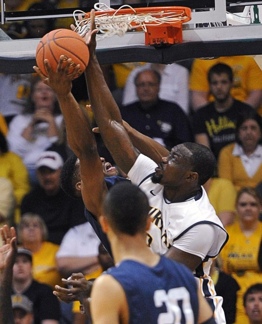Murray State's Jonathan Fairell blocks a shot by a Yale player, left, in the first half of an NCAA college basketball game for the CollegeInsider.com tournament championship, Thursday, April 4, 2014, in Murray, Ky. (AP Photo/The Ledger, Kyser Lough)