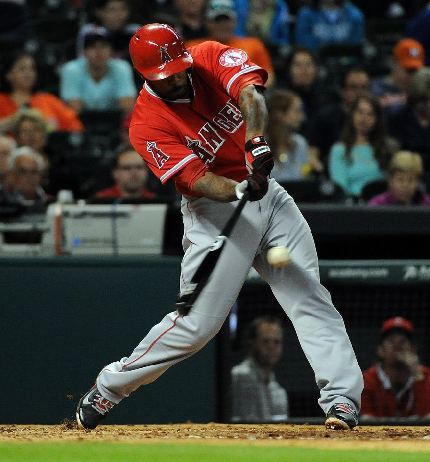 Los Angeles Angels' Howie Kendrick hits a one-run double in the third inning of a baseball game against the Houston Astros, Friday, April 4, 2014, at Minute Maid Park in Houston. (AP Photo/Eric Christian Smith)