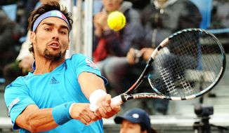 Italy's Fabio Fognini returns the ball to Britain's James Ward, during their Davis Cup World Group quarterfinal match in Naples, Italy, Friday April 4, 2014. (AP Photo/Salvatore Laporta)