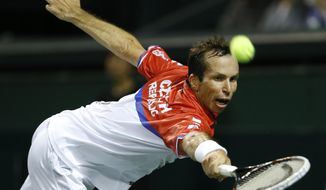 Radek Stepanek of the Czech Republic returns a shot to Tatsuma Ito of Japan during their quarterfinal of Davis Cup World Group tennis at Ariake Colosseum in Tokyo, Friday, April 4, 2014. (AP Photo/Shizuo Kambayashi)