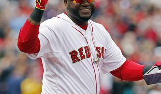 Boston Red Sox's David Ortiz holds up his World Series ring during pre-game ceremonies before a baseball game between the Red Sox and the Milwaukee Brewers on opening day at Fenway Park in Boston, Friday, April 4, 2014. (AP Photo/Michael Dwyer)