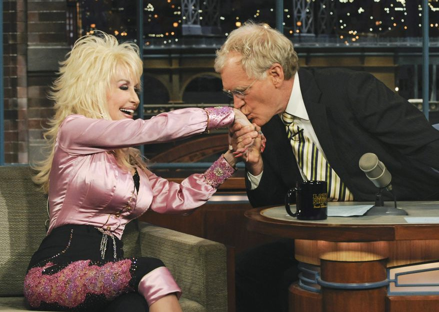 "FILE In this June 29, 2010 file photo released by CBS, host David Letterman kisses the hand of country music singer Dolly Parton on the set of the ""Late Show with David Letterman"" in New York. Letterman announced his retirement during a taping on Thursday, April 3, 2014. Although no specific date was announced he told the audience that he will leave his desk sometime in 2015. (AP Photo/CBS, Heather Wines, File) MANDATORY CREDIT; NO SALES; NO ARCHIVE; NORTH AMERICAN USE ONLY"