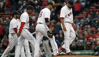 Boston Red Sox relief pitcher Edward Mujica, far right, reacts after giving up runs against the Milwaukee Brewers as his infield joins him on the mound in the ninth inning of a baseball game at Fenway Park in Boston, Friday, April 4, 2014. The Brewers won 6-2. (AP Photo/Elise Amendola)