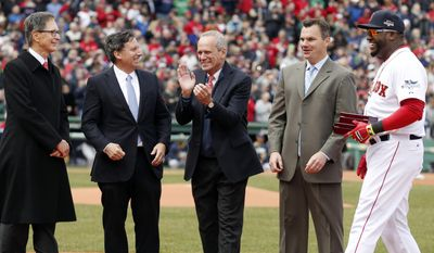 Boston Red Sox's David Ortiz, right, laughs after receiving his World Series ring from John Henry, left, Tom Werner, second from left, Larry Lucchino, center, and Ben Cherington during pre-game ceremonies before a baseball game against the Milwaukee Brewers on opening day at Fenway Park in Boston, Friday, April 4, 2014. (AP Photo/Michael Dwyer)