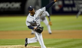 Seattle Mariners pitcher Roenis Elias delivers a pitch during the third inning of a baseball game against the Oakland Athletics, Thursday, April 3, 2014, in Oakland, Calif. (AP Photo/Beck Diefenbach)