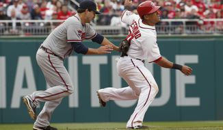 Washington Nationals shortstop Ian Desmond (20) is caught by Atlanta Braves starting pitcher David Hale (57) in a run down between third and second base during the fifth inning of a baseball home opener at Nationals Park Friday, April 4, 2014, in Washington. (AP Photo/Alex Brandon)