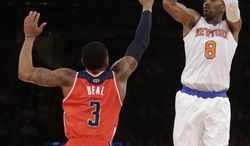 New York Knicks' J.R. Smith (8) shoots over Washington Wizards' John Wall (2) during the first half of an NBA basketball game Friday, April 4, 2014, in New York. (AP Photo/Frank Franklin II)
