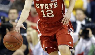 FILE - In this March 15, 2013, file photo, North Carolina State's Tyler Lewis (12) brings the ball upcourt against Virginia during the first half of an NCAA college basketball game at the Atlantic Coast Conference tournament in Greensboro, N.C. Lewis says he is transferring to Butler. In a phone interview with The Associated Press, Lewis said he looked at Purdue, Xavier, Charlotte, Gonzaga and UAB before deciding Butler was the best fit. (AP Photo/Bob Leverone, File)