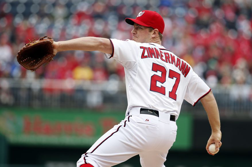 Washington Nationals starting pitcher Jordan Zimmermann throws during the first inning of a baseball home opener against the Atlanta Braves at Nationals Park Friday, April 4, 2014, in Washington. (AP Photo/Alex Brandon)