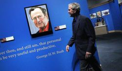 """Former President George W. Bush tours his new exhibit, """"The Art of Leadership: A President's Personal Diplomacy"""" at the George W. Bush Presidential Library and Museum in Dallas,  Tuesday, April 1, 2014. Bush, who started painting in 2012, three years after leaving office, said reading an essay by the late British Prime Minister Winston Churchill on painting inspired him to take lessons. The exhibit runs through June 3.  (AP Photo/The Dallas Morning News, Mona Reeder)  MANDATORY CREDIT; MAGS OUT; TV OUT; INTERNET USE BY AP MEMBERS ONLY; NO SALES"""