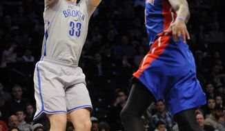 Brooklyn Nets' Mirza Teletovic (33) shoots over Detroit Pistons' Josh Smith (6) in the first half of an NBA basketball game on Friday, April 4, 2014, in New York. (AP Photo/Kathy Kmonicek)