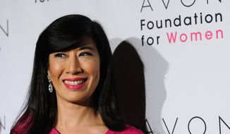 FILE - In this, Tuesday, Oct. 27, 2009, file photo, Avon Chairman and CEO Andrea Jung arrives for The Avon Foundation for Women benefit gala at Cipriani's 42nd Street in New York. The former head of Avon is now, as of Friday, April 4, 2014, leading Grameen America, a group that provides small loans to poor women entrepreneurs in the U.S. (AP Photo/Evan Agostini, File)