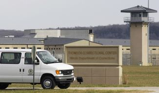 FILE - In this May 21, 2010 file photo, a van drives past the Thomson Correctional Center in Thomson, Ill. The federal Bureau of Prisons is hiring more than a dozen workers for the prison. The agency has allocated nearly $54 million to begin reopening the maximum-security penitentiary. About $10 million will be used to renovate the facility that was a state prison that never fully opened because of budget constraints. Fully activating the prison the state sold to the federal government is expected to take two years and cost about $195 million.  (AP Photo/M. Spencer Green, File)