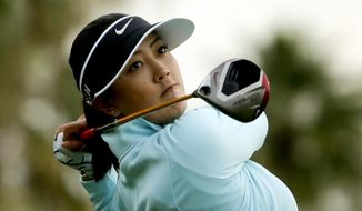 Michelle Wie watches her tee shot on the 11th hole during the second round at the Kraft Nabisco Championship golf tournament Friday, April 4, 2014, in Rancho Mirage, Calif. (AP Photo/Chris Carlson)