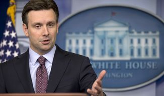 White House deputy press secretary Josh Earnest speaks during the daily news briefing at the White House in Washington, Friday, April 4, 2014. (AP Photo/Carolyn Kaster)