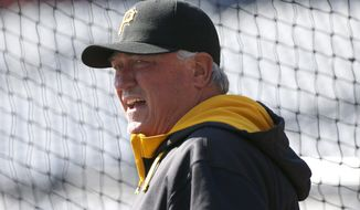 Pittsburgh Pirates manager Clint Hurdle watches during batting practice before their opening day baseball game against the Chicago Cubs on Monday, March 31, 2014, in Pittsburgh.  (AP Photo/Gene Puskar)