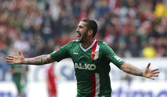 Augsburg's Sascha Moelders celebrates after scoring his side's opening goal during the German first division Bundesliga soccer match between FC Augsburg and FC Bayern, in Augsburg, southern Germany, Saturday, April 5, 2014. (AP Photo/Matthias Schrader)