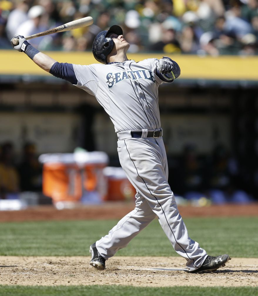 Seattle Mariners' Logan Morrison fouls off a pitch from Oakland Athletics' Dan Straily in the inning of a baseball game on Saturday, April 5, 2014, in Oakland, Calif. (AP Photo/Ben Margot)