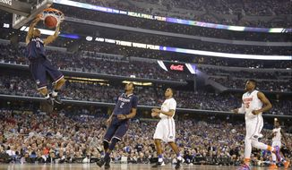 Connecticut guard Ryan Boatright dunks the ball during the second half of the NCAA Final Four tournament college basketball semifinal game against Florida Saturday, April 5, 2014, in Arlington, Texas. (AP Photo/Eric Gay)