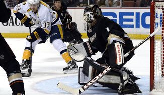 Nashville Predators center Colin Wilson (33) scores a goal agains Anaheim Ducks goalie Jonas Hiller (1) during the first period of an NHL hockey game in Anaheim, Calif., Friday, April 4, 2014. (AP Photo/Kevork Djansezian)