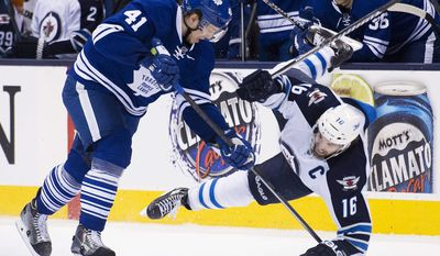 Toronto Maple Leafs forward Nikolai Kulemin (41) takes out Winnipeg Jets forward Andrew Ladd (16) during second-period NHL hockey game action in Toronto, Saturday, April 5, 2014. (AP Photo/The Canadian Press, Nathan Denette)