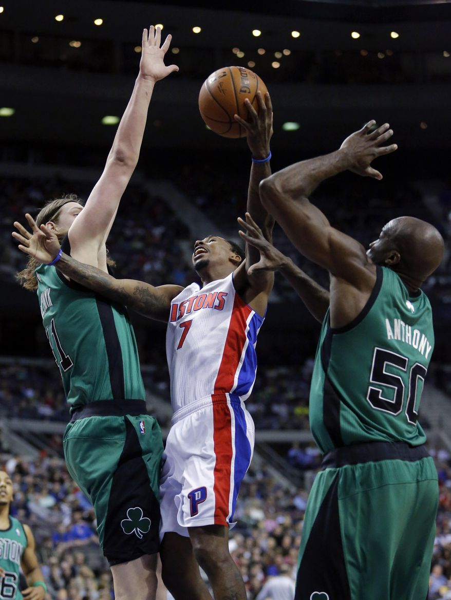 Detroit Pistons guard Brandon Jennings (7) tries going to the basket between Boston Celtics forward Kelly Olynyk, left, and center Joel Anthony (50) during the first half of an NBA basketball game Saturday, April 5, 2014, in Auburn Hills, Mich. (AP Photo/Duane Burleson)
