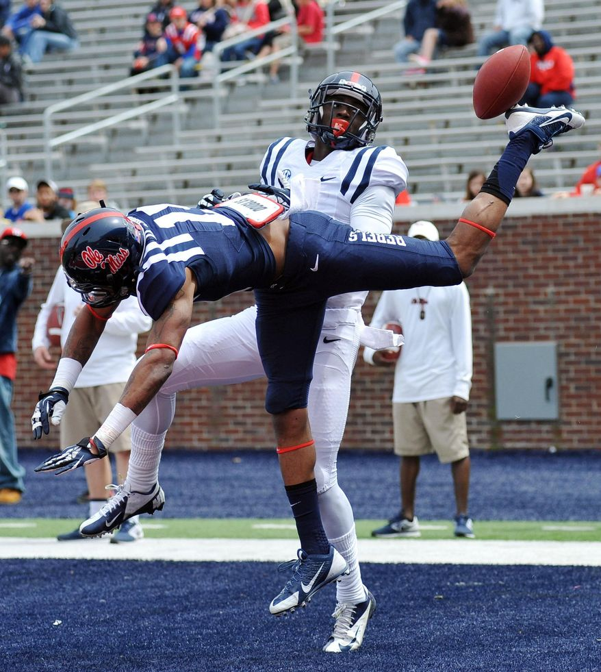 Derrick Jones (19) breaks up a pass to Laquon Treadwell during Mississippi's Grove Bowl controlled football scrimmage at Vaught-Hemingway Stadium in Oxford, Miss., Saturday, April 5, 2014. (AP Photo/Oxford Eagle, Bruce Newman) MAGAZINES OUT; NO SALES; MANDATORY CREDIT