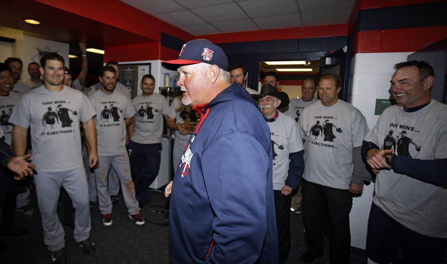 Minnesota Twins manager Ron Gardenhire talks with his team in the locker room after the Twins defeated the Cleveland Indians 7-3 in a baseball game, Saturday, April 5, 2014, in Cleveland. The Twins win Saturday gave Gardenhire his 1,000th career victory. (AP Photo/Tony Dejak)