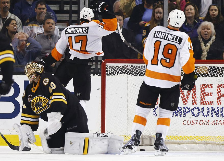 Philadelphia Flyers' Wayne Simmonds (17) celebrates his goal on Boston Bruins' Tuukka Rask (40) in the second period of an NHL hockey game in Boston, Saturday, April 5, 2014. (AP Photo/Michael Dwyer)