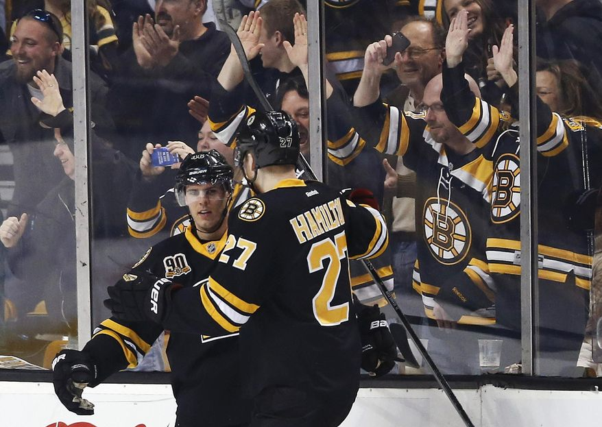 Boston Bruins' David Krejci, left, celebrates his goal with teammate Dougie Hamilton (27) in the first period of an NHL hockey game against the Philadelphia Flyers in Boston, Saturday, April 5, 2014. (AP Photo/Michael Dwyer)