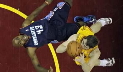 Charlotte Bobcats' Anthony Tolliver (43) is knocked down by Cleveland Cavaliers' Tyler Zeller in the first half of an NBA basketball game on Saturday, April 5, 2014, in Cleveland. (AP Photo/Mark Duncan)