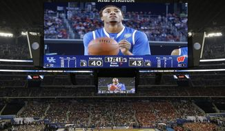 Kentucky guard James Young  takes a foul shot against Wisconsin during the second half of the NCAA Final Four tournament college basketball semifinal game Saturday, April 5, 2014, in Arlington, Texas. (AP Photo/Tony Gutierrez)