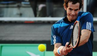 Britain's Andy Murray returns the ball to Italy's Andreas Seppi during their Davis Cup World Group quarterfinal match in Naples, Italy, Friday, April 4, 2014. (AP Photo/Salvatore Laporta)