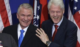 Former President Bill Clinton, right, and Former Federal Emergency Management Agency Director James Lee Witt greet a crowd at a political fundraiser in Hot Springs, Ark., Saturday, April 5, 2014. Witt is running for Congress in Arkansas 4th district. (AP Photo/Danny Johnston)