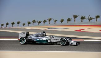 Mercedes driver Lewis Hamilton of Britain steers his car during the third free practice ahead of the Bahrain Formula One Grand Prix at the Formula One Bahrain International Circuit in Sakhir, Bahrain, Saturday, April 5, 2014. (AP Photo/Hassan Ammar)