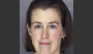 FILE - This Tuesday, April 1, 2014 file booking photograph released by the Allegheny County Police shows Laurel Michelle Schlemmer, who is charged with drowning her 3-year-old son and leaving his 6-year-old brother in critical condition Tuesday, April 1 after she allegedly pushed the boys underwater in a bathtub, then sat on them at their McCandless, Pa. home.  Daniel Schlemmer, 6, has died, four days after his younger brother drowned, the Allegheny County Medical Examiner's Office confirmed Saturday, April 5, 2014. (AP Photo/Allegheny County Police, File)