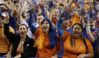 Florida fans cheer before an NCAA Final Four tournament college basketball semifinal game against Connecticut, Saturday, April 5, 2014, in Arlington, Texas. (AP Photo/David J. Phillip)