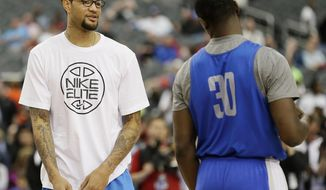 Kentucky forward Willie Cauley-Stein and forward Julius Randle talk during practice for their NCAA Final Four tournament college basketball semifinal game Friday, April 4, 2014, in Dallas. Kentucky plays Wisconsin on Saturday, April 5, 2014. (AP Photo/Charlie Neibergall)