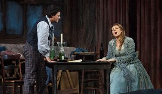 "In this photo provided by the Metropolitan Opera, Vittorio Grigolo portrays Rodolfo with Kristine Opolais as Mimi in the Metropolitan Opera's Live in HD broadcast of Puccini's ""La Boheme,"" Saturday, April 5, 2014 in New York. Opolais made Metropolitan Opera history Saturday, stepping in for an ailing soprano to make her second company role debut in a span of 24 hours. On Friday night, Opolais sang Cio-Cio-San in Puccini's ""Madama Butterfly."" (AP Photo/Metropolitan Opera, Marty Sohl)"