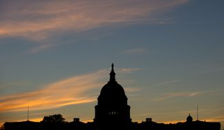 In this Sept. 15, 2013, file photo, the U.S. Capitol dome is silhouetted by the sunrise. (AP Photo/Carolyn Kaster, File)