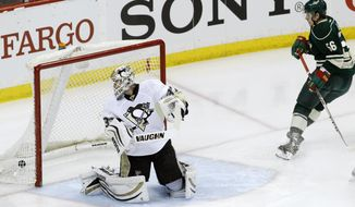 Minnesota Wild left wing Erik Haula (56), of Finland, scores against Pittsburgh Penguins goalie Jeff Zatkoff, left, during the first period of an NHL hockey game in St. Paul, Minn., Saturday, April 5, 2014. (AP Photo/Ann Heisenfelt)