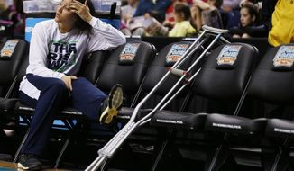 Notre Dame's Natalie Achonwa watches practice  before the women's Final Four of the NCAA college basketball tournament, Saturday, April 5, 2014, in Nashville, Tenn. Notre Dame will play Maryland Sunday. (AP Photo/John Bazemore)