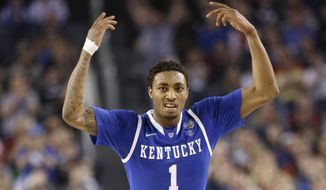 Kentucky guard James Young celebrates during the second half of an NCAA Final Four tournament college basketball semifinal game against Wisconsin Saturday, April 5, 2014, in Arlington, Texas. (AP Photo/David J. Phillip)