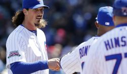 Chicago Cubs starter Jeff Samardzija, left, talks to Emilio Bonifacio as he walks walks back to the dugout during the third inning of a baseball game against the Philadelphia Phillies in Chicago, Saturday, April 5, 2014. (AP Photo/Nam Y. Huh)
