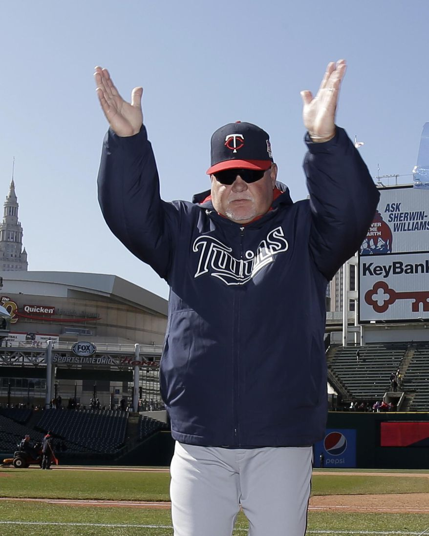 Minnesota Twins manager Ron Gardenhire acknowledges the Twins fans after the Twins defeated the Cleveland Indians 7-3 in a baseball game, Saturday, April 5, 2014, in Cleveland. The Twins win Saturday gave Gardenhire his 1,000th career victory. (AP Photo/Tony Dejak)