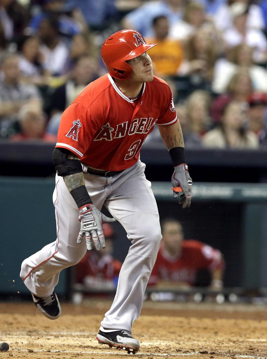 Los Angeles Angels' Josh Hamilton watches the ball go over the wall for a two-run home run against the Houston Astros in the fifth inning of a baseball game on Saturday, April 5, 2014, in Houston. (AP Photo/Pat Sullivan)