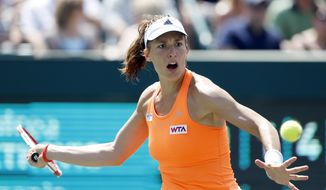 Andrea Petkovic, of Germany, returns to Eugenie Bouchard, of Canada, during the Family Circle Cup tennis tournament in Charleston, S.C., Saturday, April 5, 2014. Petkovic won 1-6, 6-3, 7-5. (AP Photo/Mic Smith)