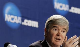 NCAA President Mark Emmert answers a question at a news conference Sunday, April 6, 2014, in Arlington, Texas. (AP Photo/Eric Gay)